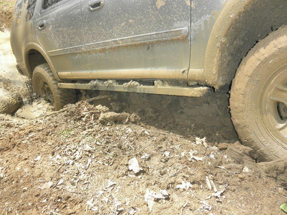 Ford Expedition offroad in the dirt and mud